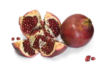 solid and cut pomegranates isolated with white background