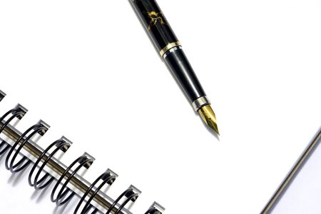 Notebook with ink-pen in white background Stock Photo - 2150975