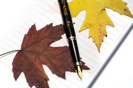 Ink pen with writing-pad and fall golden leafs Stock Photo - 2151035