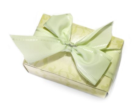 surprise with green and silver ribbon on white background