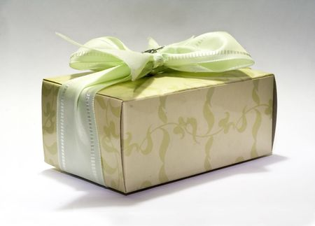 Christmas surprise with green and silver ribbon on white background 5