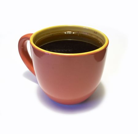 glazed pottery coffee cup with coffee on white background