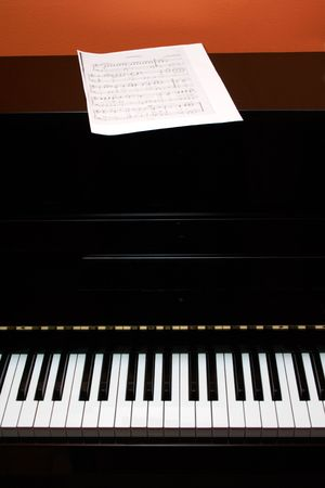 Piano with note papers photo
