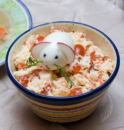 Chinese 2008 New Year symbolic mouse made from egg and radish at the top of served salad photo