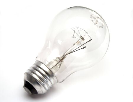 Transparent light bulb at white background photo