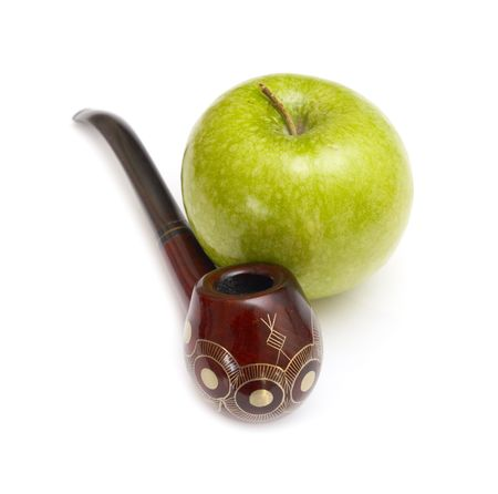 Long ornamented north-caucasian pipe with big green apple at white background Stock Photo - 2597348