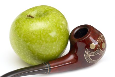 ornamented: Long ornamented north-caucasian pipe with big green apple at white background