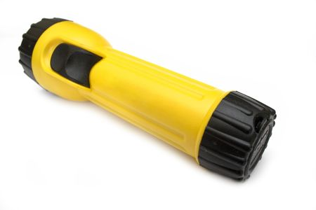 Yellow and black flashlight with white background photo