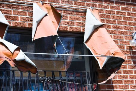 jalousie: Window of downtown grocery with damaged shed Stock Photo