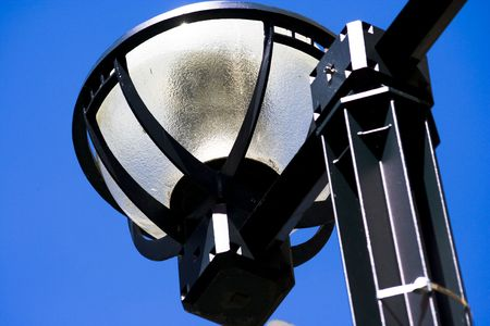 Macro close-up of urban style lantern in downtown Toronto with blue sky