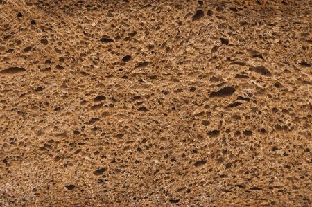 freshly baked rye bread with bran and cereal seeds: texture close-up