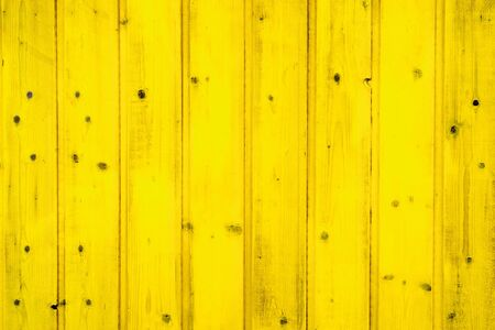 yellow painted wooden planks closeup - texture for design