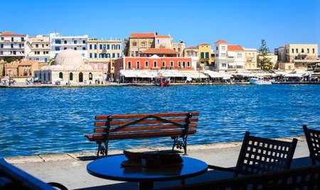 Rethymnon, Crete, Greece - August 15, 2015: bench overlooking the Venetian port of Rethymnon