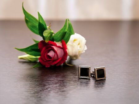cufflinks and groom boutonniere