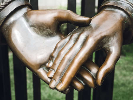 part of a bronze sculpture - hand in hand, close-up Banque d'images