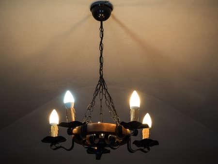 vintage chandelier shines in the dark in the castle
