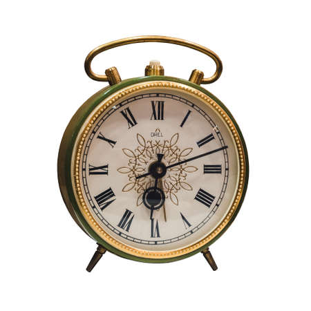 old green and golden color alarm clock with roman numerals in the museum. Isolated Reklamní fotografie
