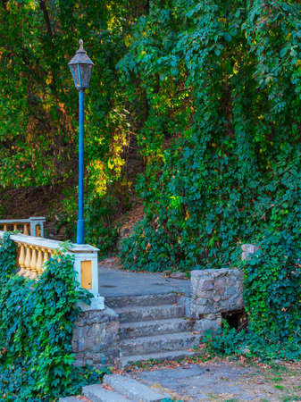 vintage lantern and balustrades in the park, steps and green ivy Archivio Fotografico
