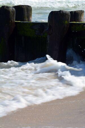 onto: Waves Washing onto Shore Along Pier