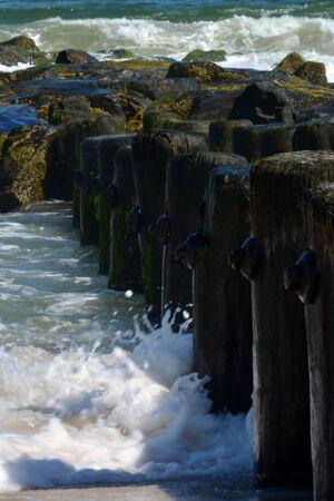 waves crashing: Waves Crashing Against Pier