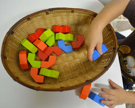 Grandson playing with blocks in a basket