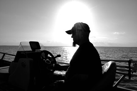 My husband was driving the boat on lake Livingston when sun ended beside us and made a silhouette photo
