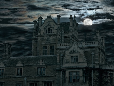 Spooky moon rise over old house in England Uk