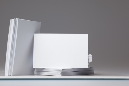 card holder: Blank Business cards to add own image in pile with stack of cards to side Stock Photo