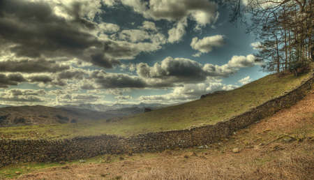 Dry stone wall and clouds in lake distict, photo
