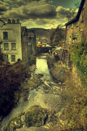 View down river in ambleside showing water wheel photo