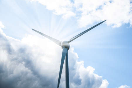 Close up view of turbine blades with sun photo