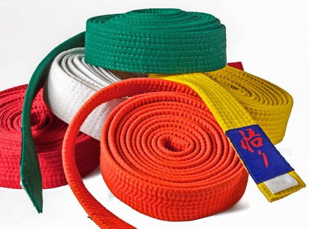 jujitsu: collection of karate belts piled on top of each other Stock Photo