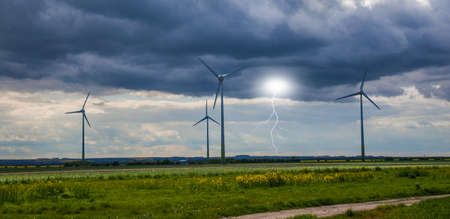 Wind farm with lightning photo