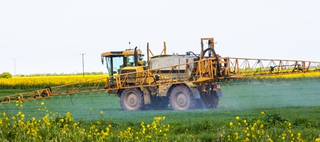 A tractor spraying crops photo