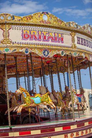 Carrousel with painted horses