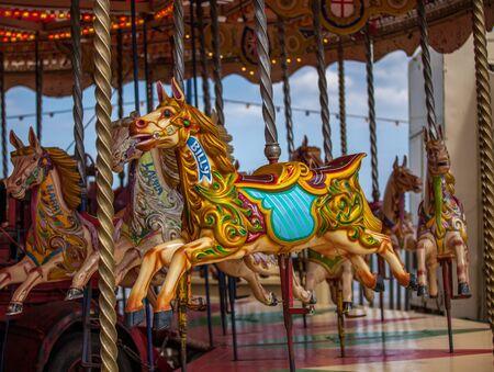 carrousel: billy the carrousel horse on fairground ride