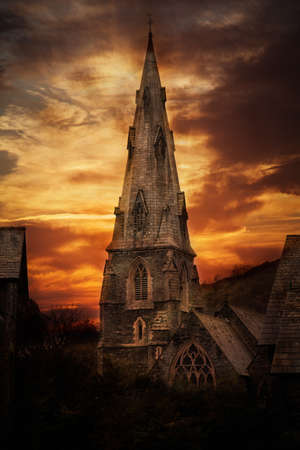 Church at sunset with orange clouds Stock Photo - 16867794