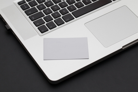 macbook: Business card on a laptop keyboard