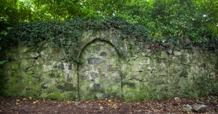 ivy wall: Wall of a castle in wales with bricked up doorway
