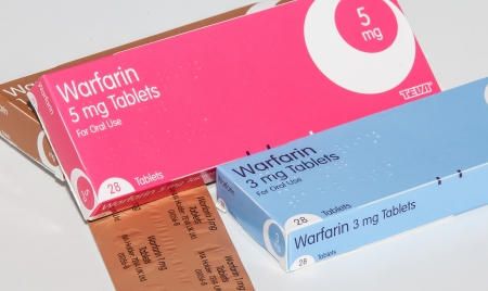 Cleethorpes, England - December 21, 2013: Boxes of anticoagulant drug warfarin on white background