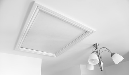 Picture of a loft hatch in white painted room Standard-Bild