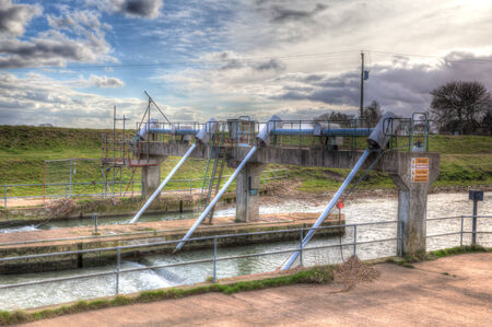 Tidal weir in lincolnshire salt marsh photo