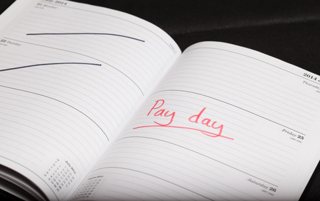 Pay day highlighted in a diary Stock Photo