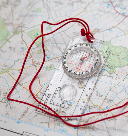 Shot of Orienteering compass on string Standard-Bild