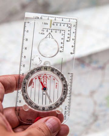 Shot of Orienteering compass on string photo