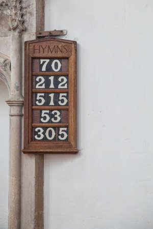 hymn: Hymm Board in a church