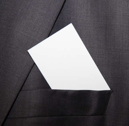 Business card being placed in pocket photo