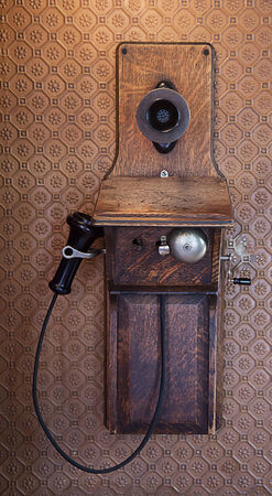 Very old wooden telephone on wall Stock Photo - 30259577