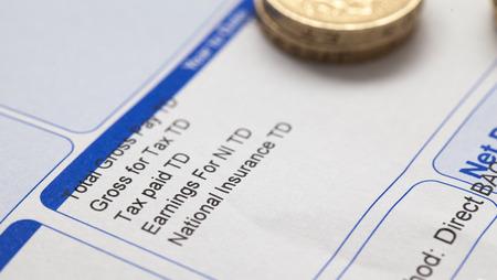 monthly salary: Pay slip close up macro shot
