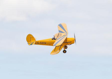 airshow: CLEETHORPES, ENGLAND JULY 27TH: Stampe  perform an aerobatic display at Cleethropes airshow on 27th July 2014 in Cleethorpes England.